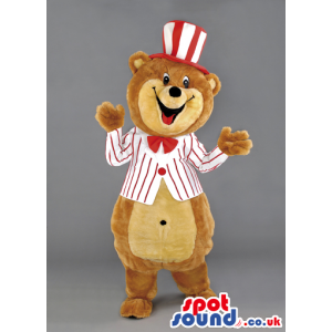 Overjoyed teddy bear mascot with red bow tie and striped hat -