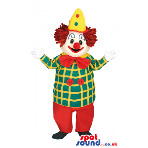 Lively smiling clown mascot with colorful outfit and red bow