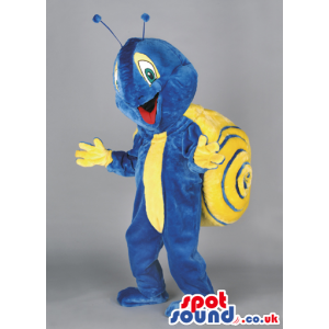 Delighted blue snail mascot with yellow shell and antennae -
