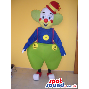 Colorful Clown Mascot Wearing Big Pants And Smiley Faces -