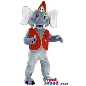 Standing elephant mascot with red vest and hat and white tusk -