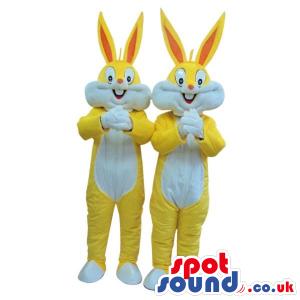 Two Bugs Bunny Alike Cartoon Character Mascots In Yellow -
