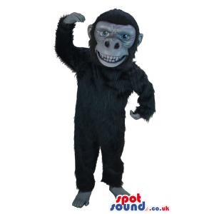 Black orangutan mascot with soft black fur and large grin -