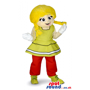 Cute smiling girl mascot with yellow dress and red trousers -