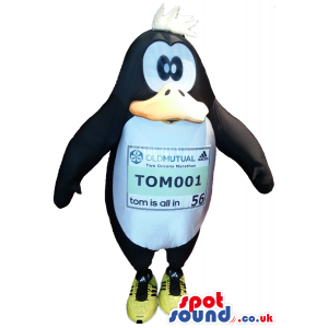 Funny Cartoon Penguin Plush Mascot With A Label On Its Belly -