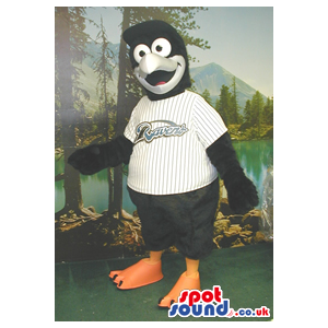 Black Bird Plush Mascot Wearing A Baseball Shirt With A Team