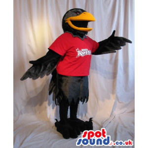 Black Bird Plush Mascot Wearing A Red T-Shirt With A Logo. -