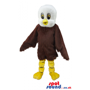 Standing eagle mascot with brown feathers and white head -