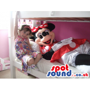 Large Minnie mouse mascot in red and white polka dot dress -