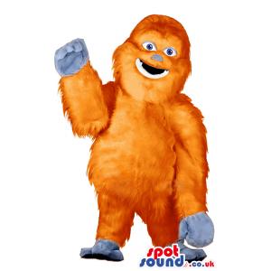 Big jubilant orange gorilla mascot with grey palms and feet -