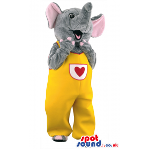 Jubilant elephant mascot wearing yellow overalls with red heart