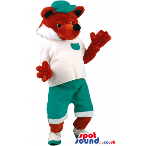 Pleased fox mascot with green cap, white T-shirt and shoes -
