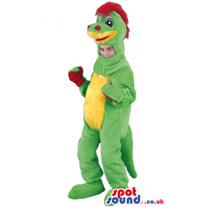 Standing green dinosaur mascot with red hair, palms and