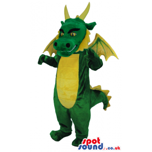 Tall manacing looking green dragon with yellow spines and horns