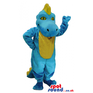 Standing blue dragon mascot with yellow spines amd underbelly -