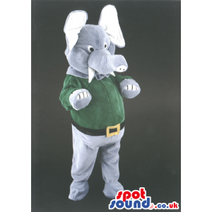 Standing elephant mascot with green jumper and black belt -