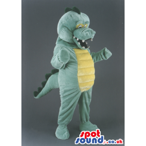 Overjoyed green dragon mascot with spines and yellow underbelly