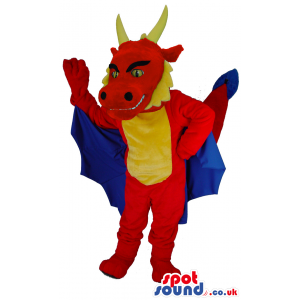 Red dragon mascot with yellow horns and spines and blue wings -