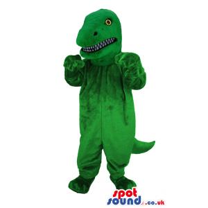 Green roaring dinosaur with yellow eyes and sharp teeth -