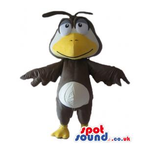 Black bird with white big head, big yellow beak, big eyes and a