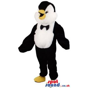 Penguin -like mascot in black and white with a cute smile -