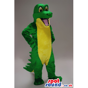 Green crocodile mascot with big yellow eyes and white teeth -