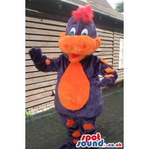Friendly purple dragon mascot with red hair and orange snout. -