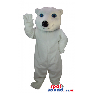 Cute looking and smiling polar bear mascot with naïve blue eyes