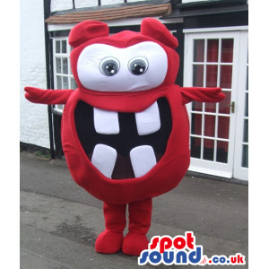 Red monster mascot with big round eyes and white squared teeth